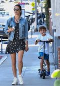 Alessandra Ambrosio wears a short black dress and denim jacket as she takes her kids for ice cream in Brentwood, Los Angeles