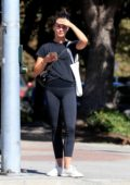 Alicia Vikander dressed casually in a black tee and leggings for a walk in West Hollywood, Los Angeles