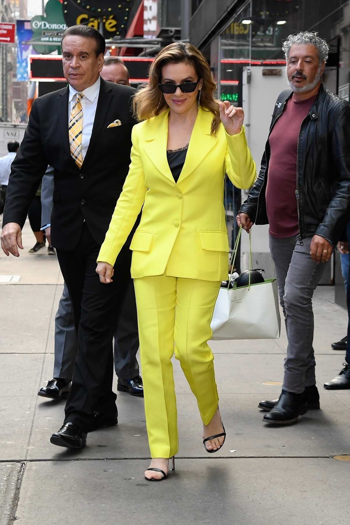 Alyssa Milano looks vibrant in a lemon yellow suit while visiting 'Good Morning America' in New York City