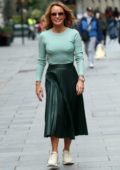 Amanda Holden wears a mint green top and dark green skirt as she leaves Heart Radio show in London, UK