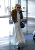 Amber Heard keeps it stylish as she arrives for a flight out of JFK Airport in New York City