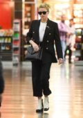 Amber Heard looks stylish as she touches down at JFK Airport in New York City
