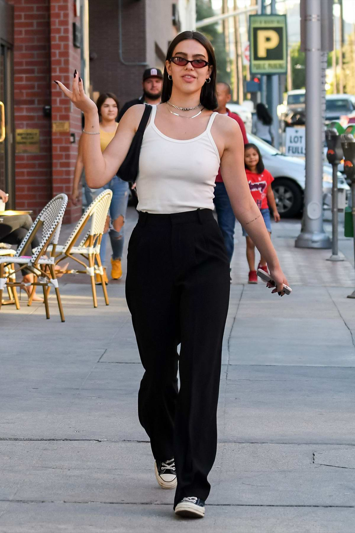 Amelia Hamlin spotted in a white camisole top and black trousers while visiting a nail salon in Los Angeles