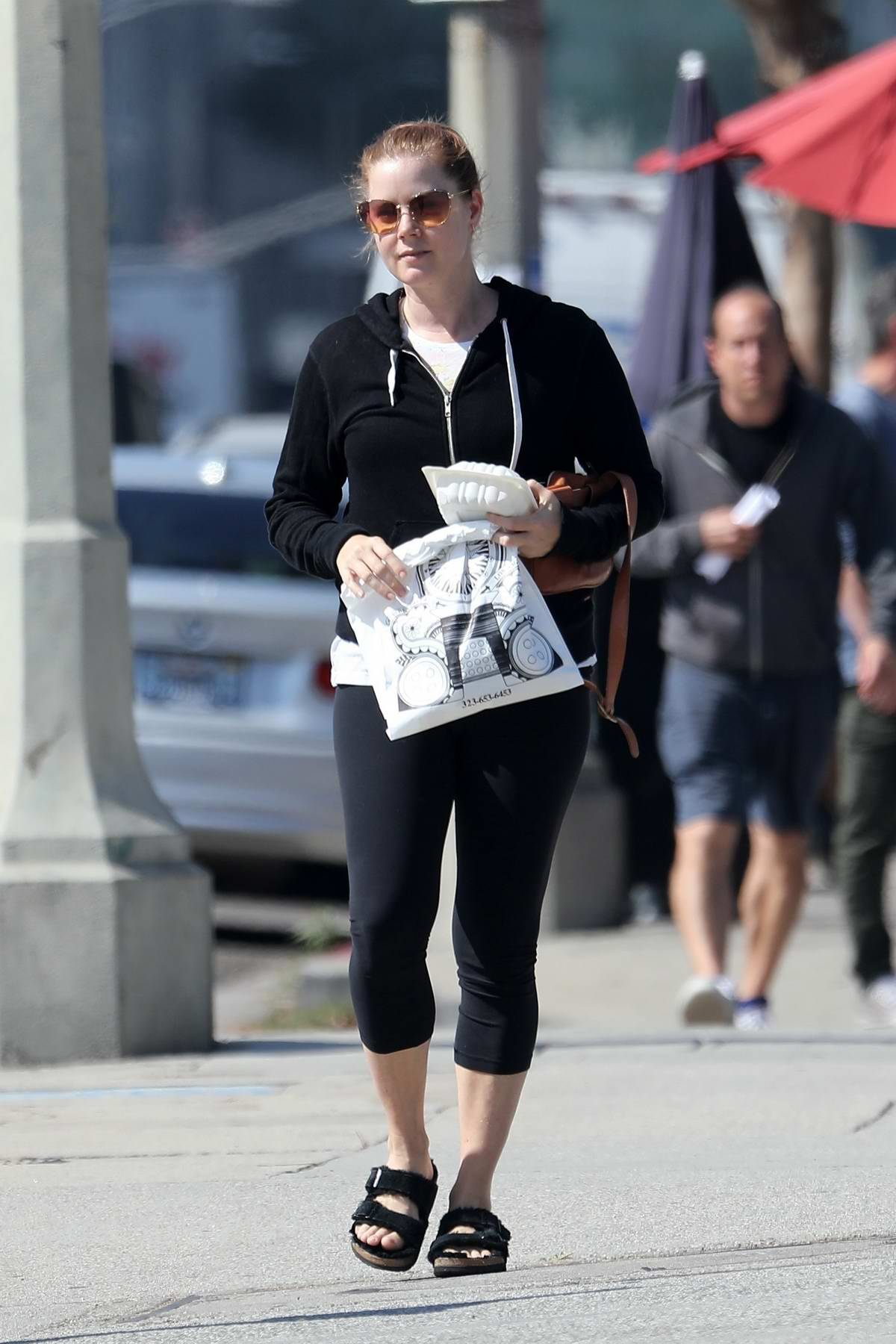 Amy Adams wears a black hoodie and legging while meeting a friend for breakfast at Kings Road Café in West Hollywood, Los Angeles