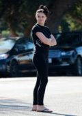 Ariel Winter keeps it casual in a black tee and leggings while running errands in Los Angeles