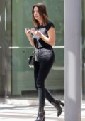 Ashley Benson dons all black as she arrives at an office building in Century City, California