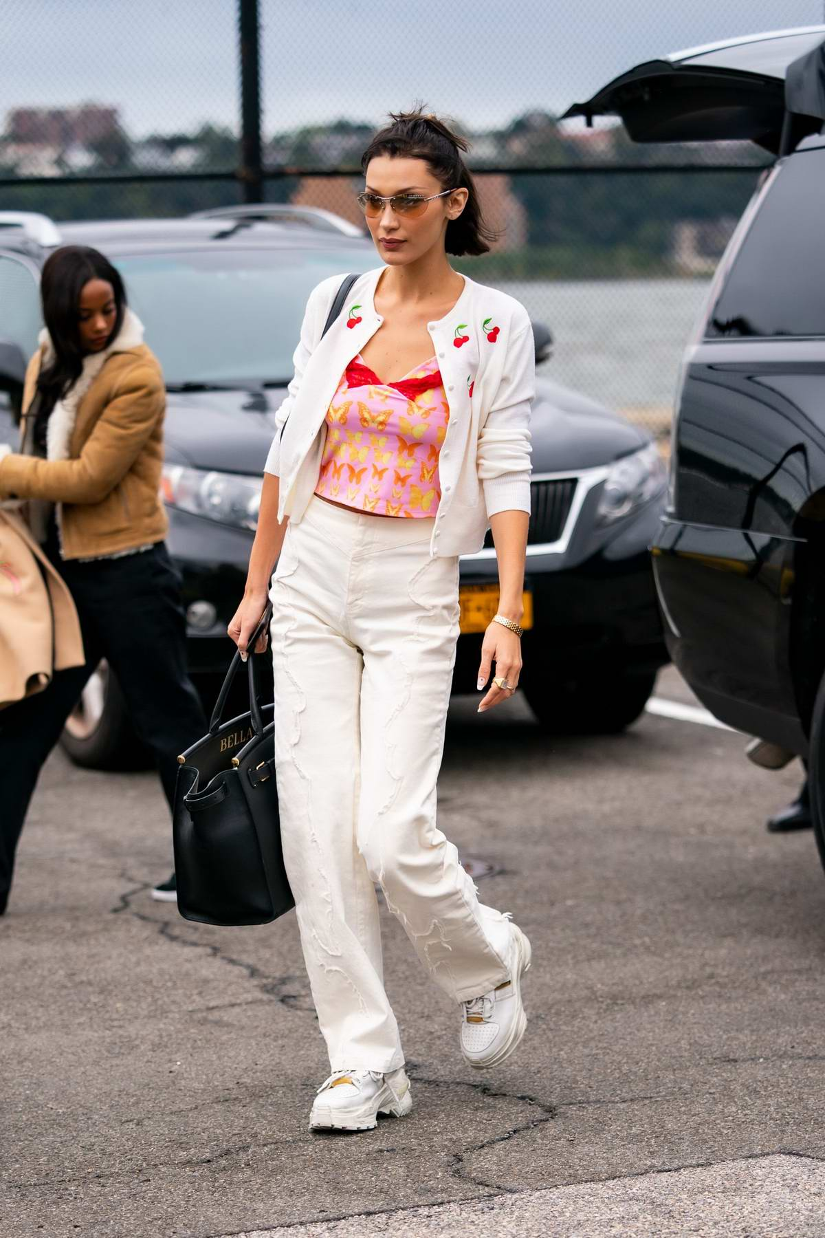 Bella Hadid looks great in white cardigan with matching pants as she takes a helicopter out of New York City