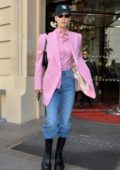 Bella Hadid looks stylish in a pink blazer and matching shirt as she leaves her hotel in Paris, France