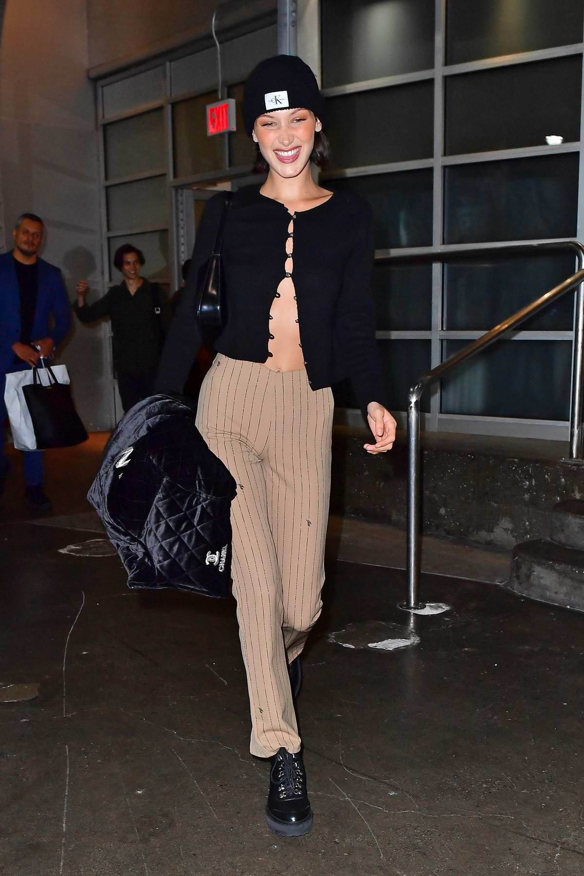 Bella Hadid smiles for the camera as she leaves the Pier59 Studio in New York City