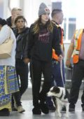 Bella Thorne and new girlfriend Alex Martini hold hands before flying out of Toronto, Canada