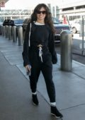 Camila Cabello looks cheerful as she arrives for a flight out of LAX Airport in Los Angeles