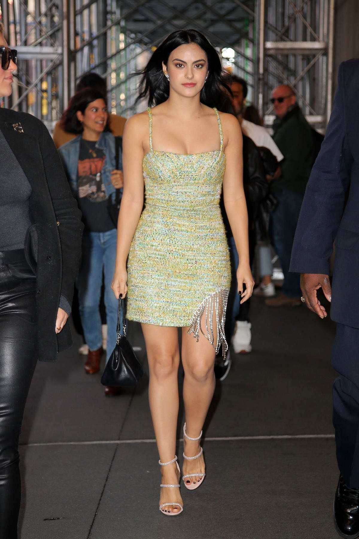 Camila Mendes looks gorgeous in a green mini dress while stepping out in New York City
