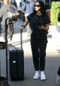 Camila Mendes spotted in a black tee and jeans as she steps out with luggage in New York City