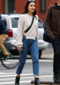 Camila Mendes wears a cream sweater, cropped jeans and ankle boots while out for stroll in New York City