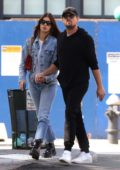 Camila Morrone and Leonardo DiCaprio hold hands as they step out for a stroll after having lunch in Downtown Manhattan, New York City