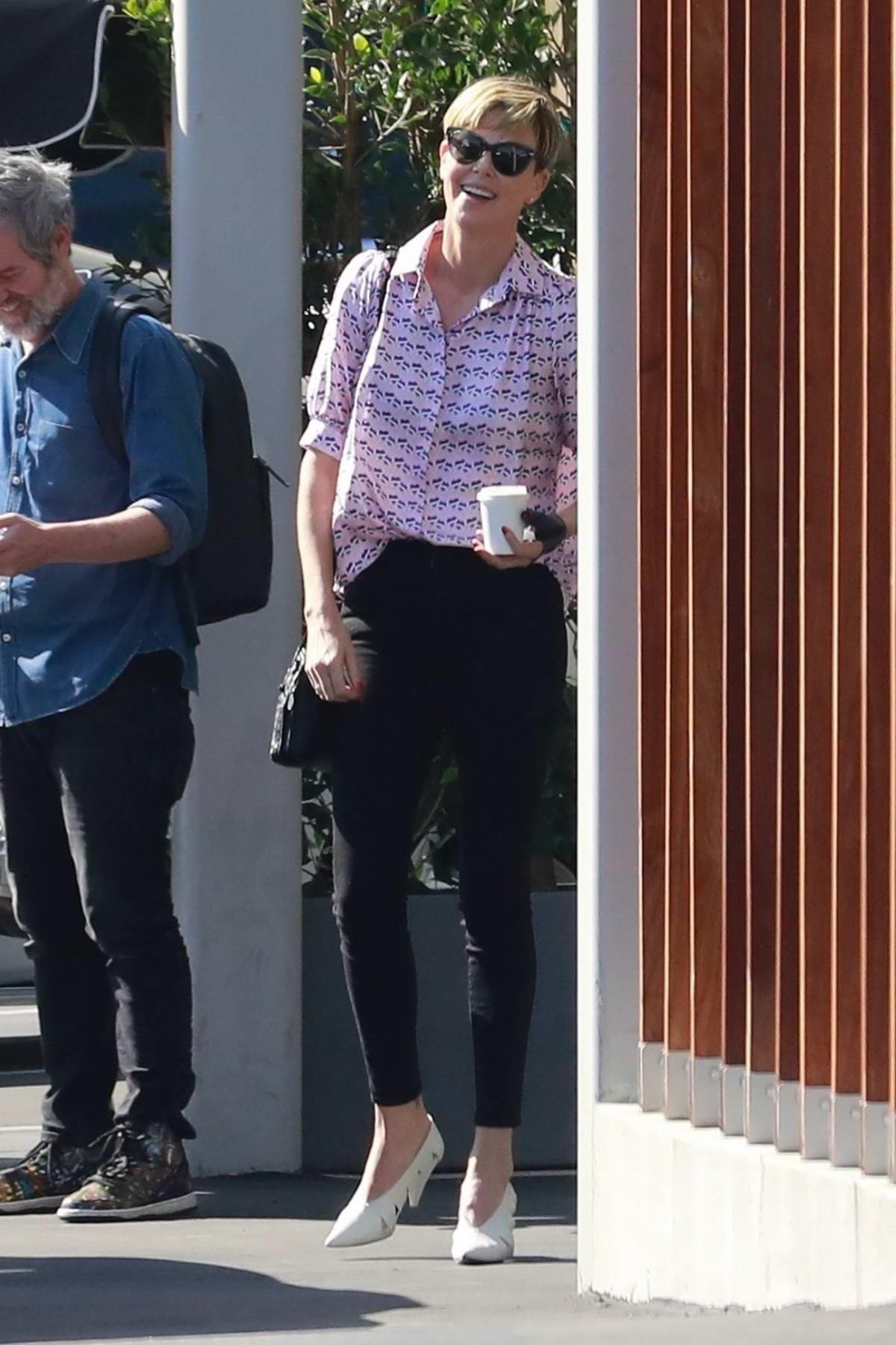 Charlize Theron has a laugh by the Valet booth while out with friends in Culver City, California