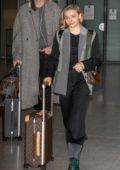 Chloe Grace Moretz spotted with her Louis Vuitton luggage as she touches down at Charles-de-Gaulle airport in Paris, France