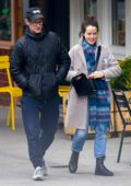 Claire Foy and Matt Smith put on a very playful display as they hold hands and head for lunch together in London, UK