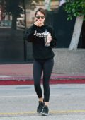 Dakota Johnson rocks a black hoodie with matching leggings and sneakers as she leaves the gym in Los Angeles