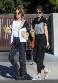 Dakota Johnson rocks a pair of Gucci sneakers while out with her friend for matcha drinks at Cha Cha Matcha in West Hollywood, Los Angeles