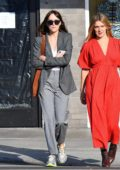 Dakota Johnson sports a grey monochromatic look as she heads to lunch with a friend in Los Angeles