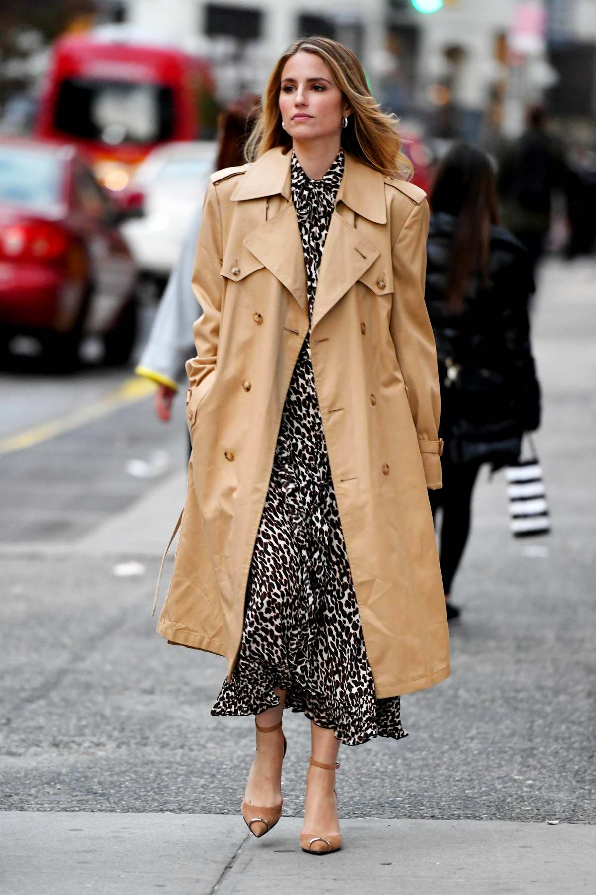Dianna Agron makes a stylish appearance donning an animal print dress paired with a trench coat in New York City