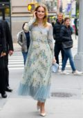 Elizabeth Lail looks beautiful in a floral print dress while posing for photos outside Build Studio in New York City