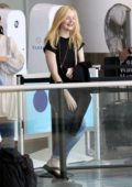 Elle Fanning goes make-up free and full of energy as she prepares to catch a flight out of Los Angeles