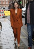 Emilia Clarke is all smiles as she arrives at her hotel while promoting new movie 'Last Christmas' in London, UK