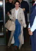 Emilia Clarke is all smiles as she leaves The Whitby Hotel wearing an oversized trench coat in New York City