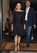 Emilia Clarke looks great in a black dress as she leave her hotel in London, UK