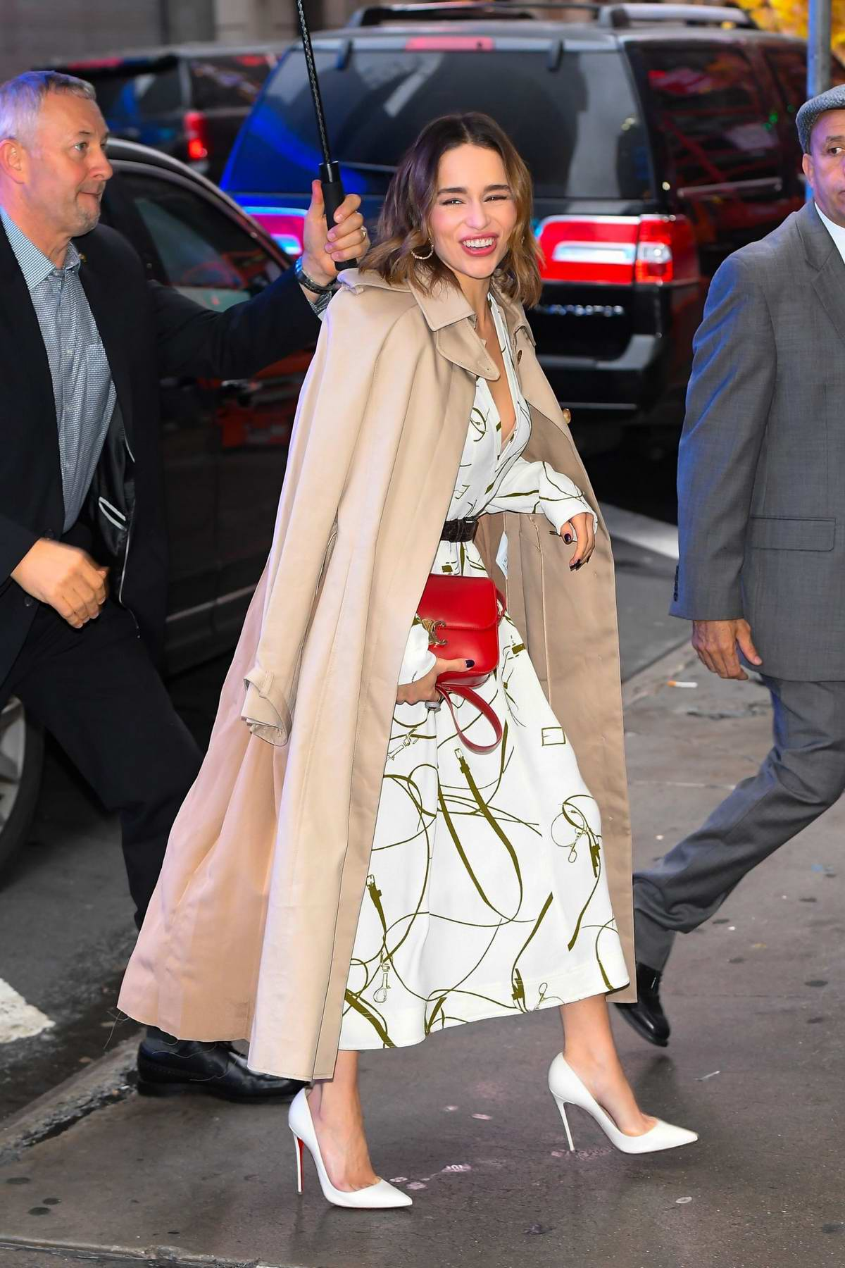 Emilia Clarke looks lovely in a white dress as she arriving at Good Morning America in New York City