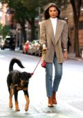Emily Ratajkowski keeps it classy with a white turtleneck and brown blazer while walking her dog in New York City