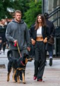 Emily Ratajkowski rocks a white crop top and pinstriped suit while out with Sebastian Bear-McClard in New York City