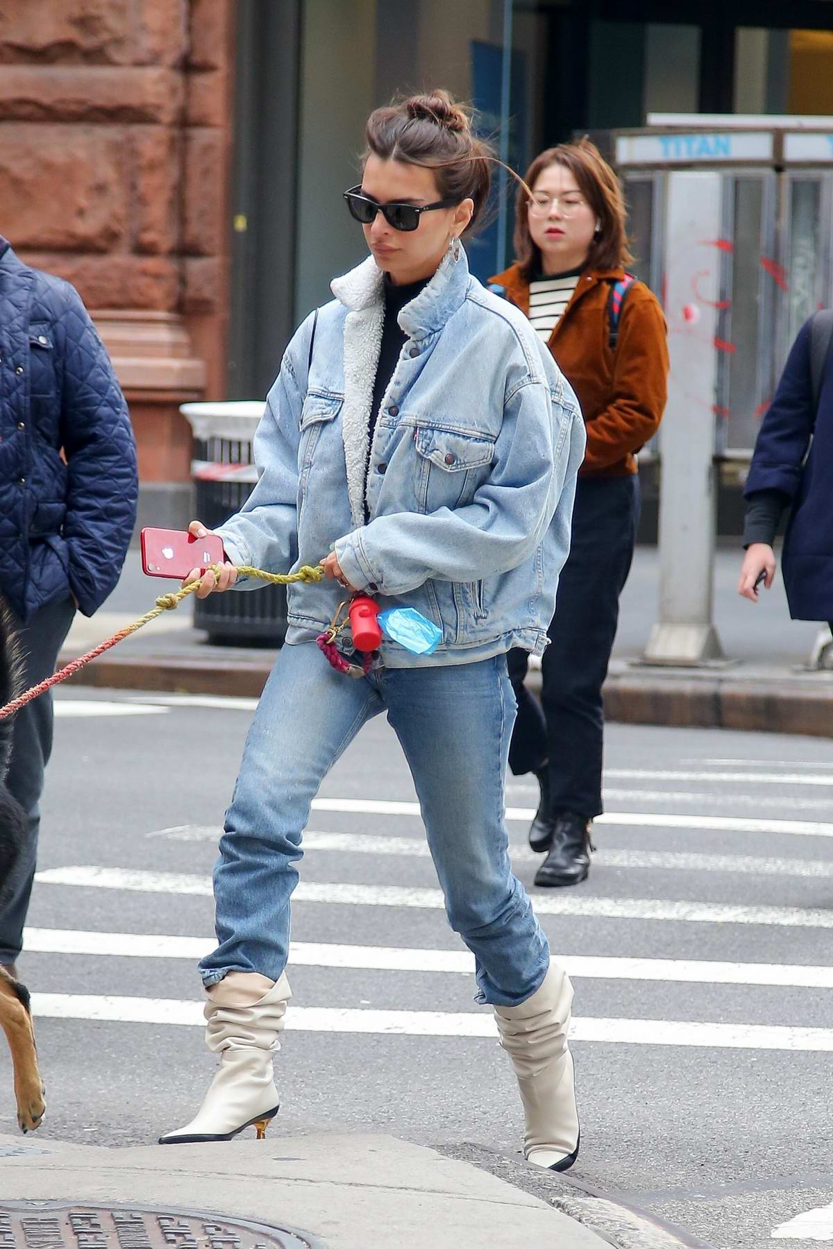 Emily Ratajkowski rocks double denim while out for a stroll with her dog in New York City