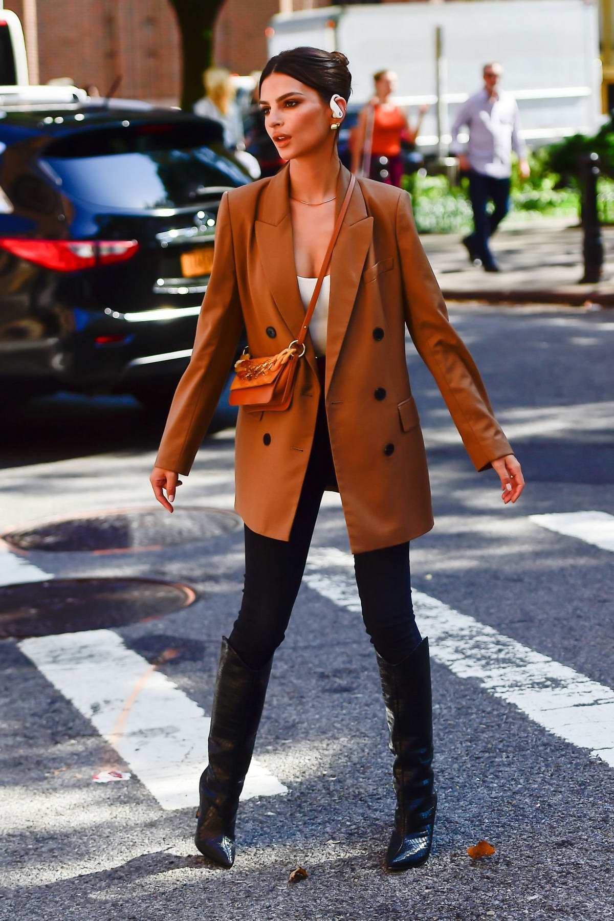 Emily Ratajkowski seen during a photoshoot for Beats headphones in New York City