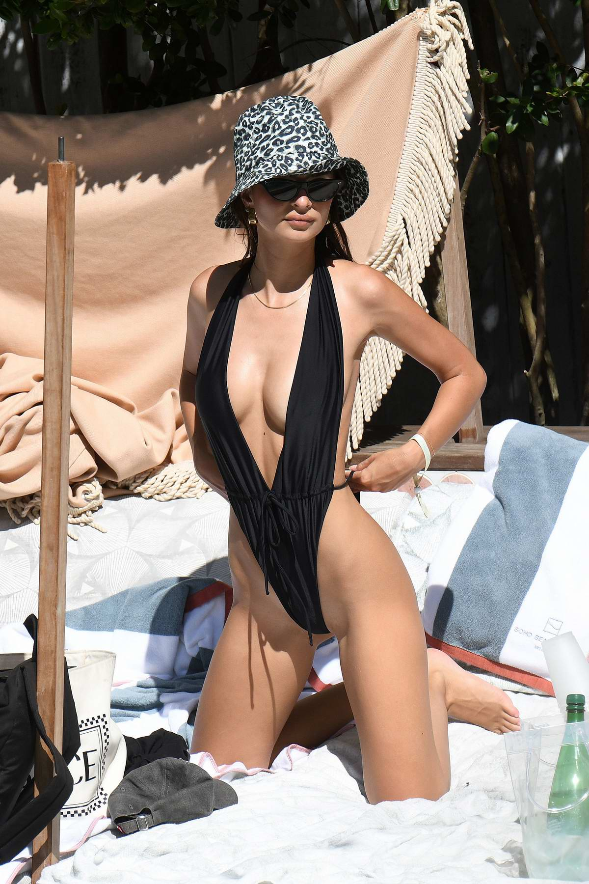 Emily Ratajkowski stuns in a black monokini swimsuit during relaxing pool day in Miami, Florida