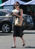 Emma Roberts wears a floral print black dress as she steps out to grab lunch in Los Feliz, California