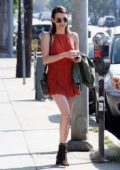 Emma Roberts wears a red mini dress for a lunch outing with Garrett Hedlund in Los Feliz, California