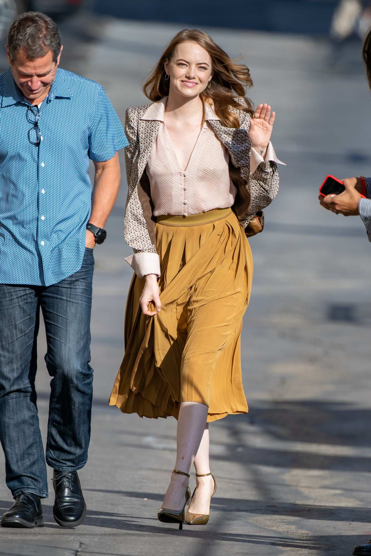 Emma Stone is all smiles as she arrives for an appearance on 'Jimmy Kimmel Live!' in Hollywood, California