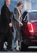Emma Stone looks stunning in grey velvet cowl neck dress as she arrives at Jennifer Lawrence's wedding in Newport, Rhode Island