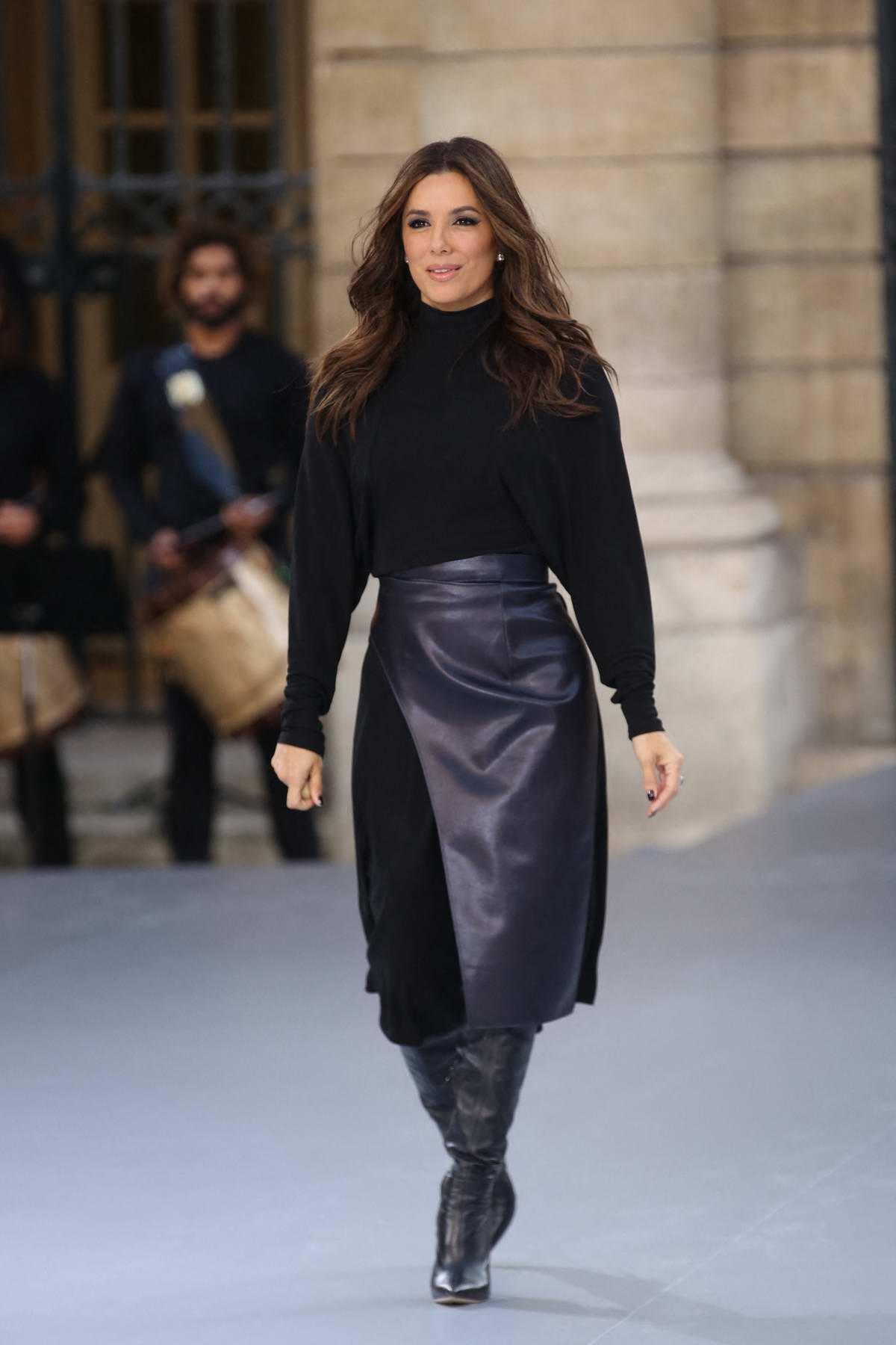 Eva Longoria walks the runway at the L'Oreal Paris Spring/Summer 2020 show during Paris Fashion Week in Paris, France