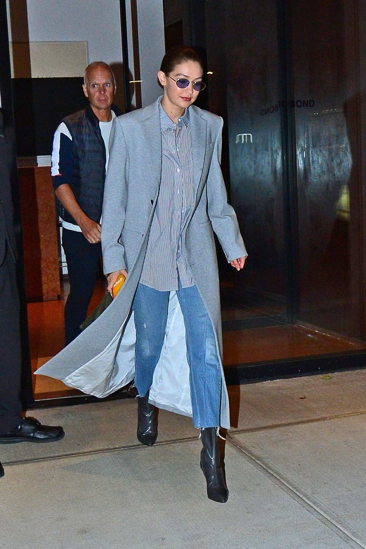 Gigi Hadid looks chic in a long grey coat as she steps out in Manhattan, New York City