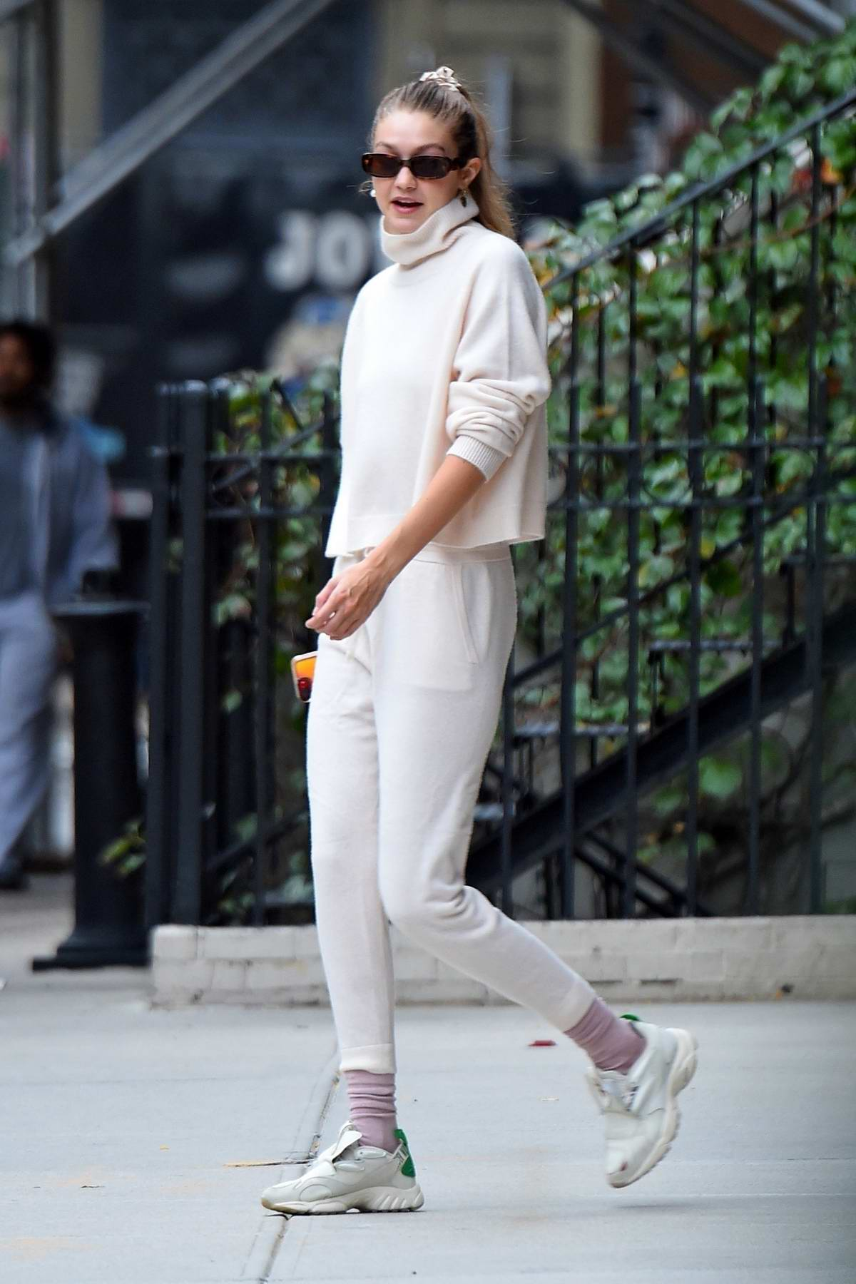Gigi Hadid looks comfy in white casuals as she steps out with her mother in Manhattan, New York City