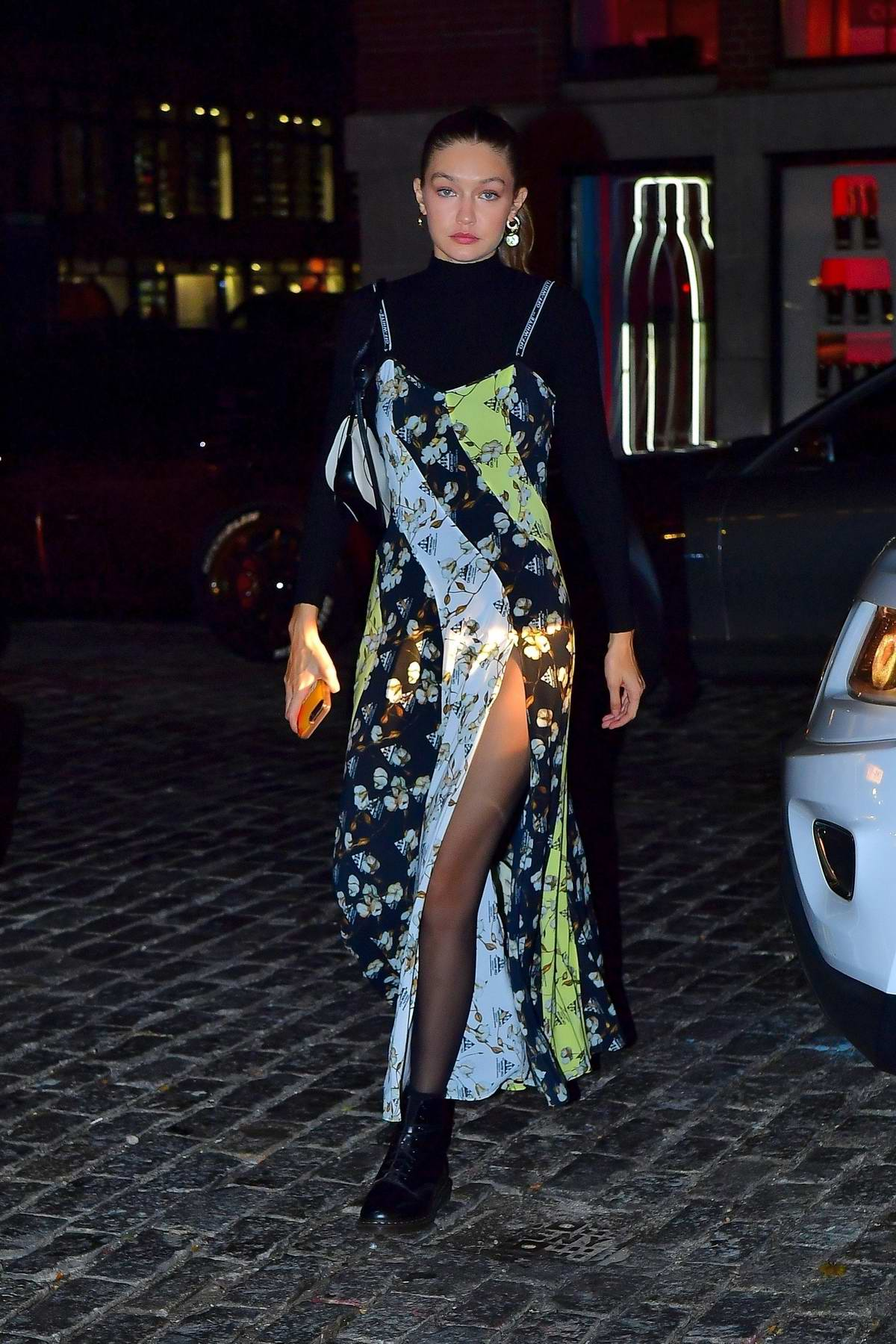 Gigi Hadid looks striking in a floral dress as she steps out for a dinner party in New York City