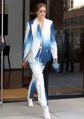 Gigi Hadid rocks a two-toned blue and white pantsuit as she to head to a friend's art exhibition in New York City