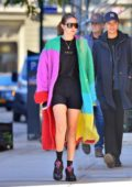 Gigi Hadid wears a color-blocked fuzzy long coat during an afternoon stroll in New York City