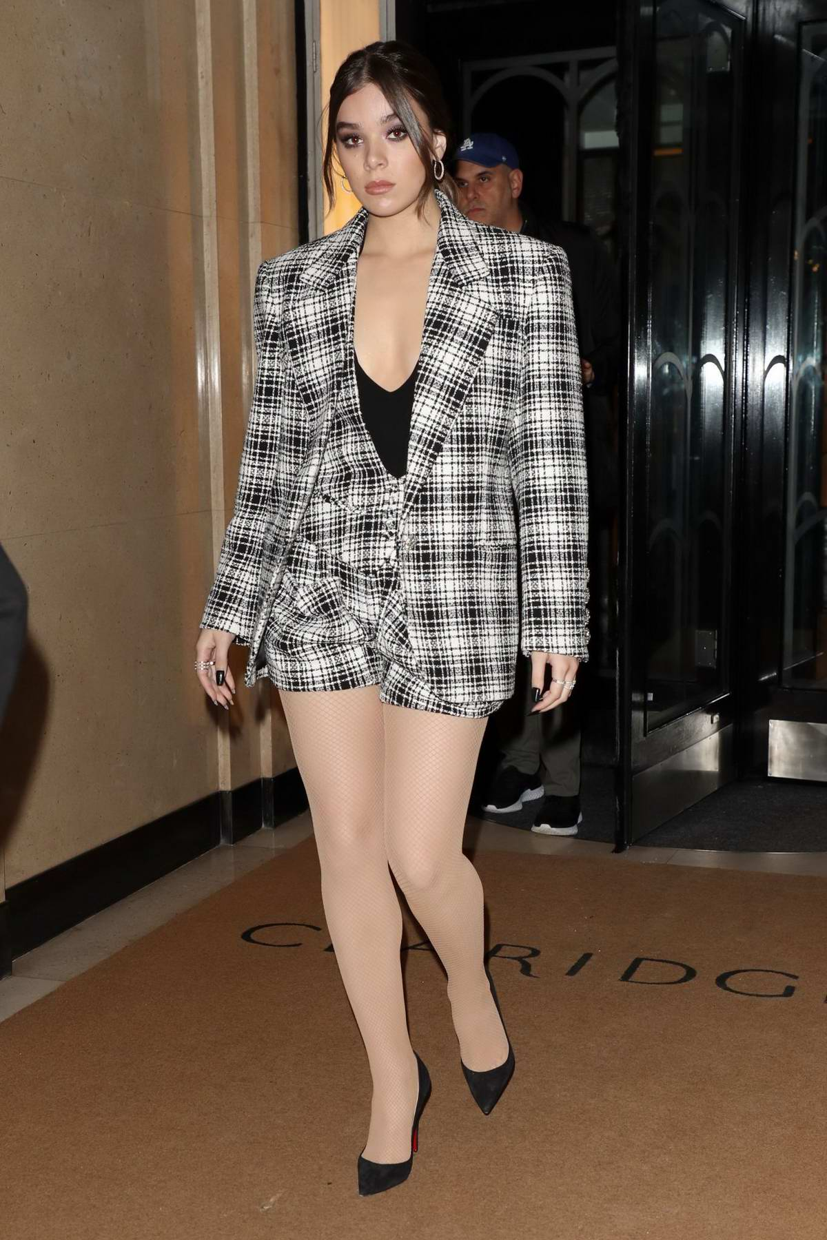 Hailee Steinfeld looks cute in plaid as she leaves Claridge's Hotel ahead of her BBC One Show appearance in London, UK