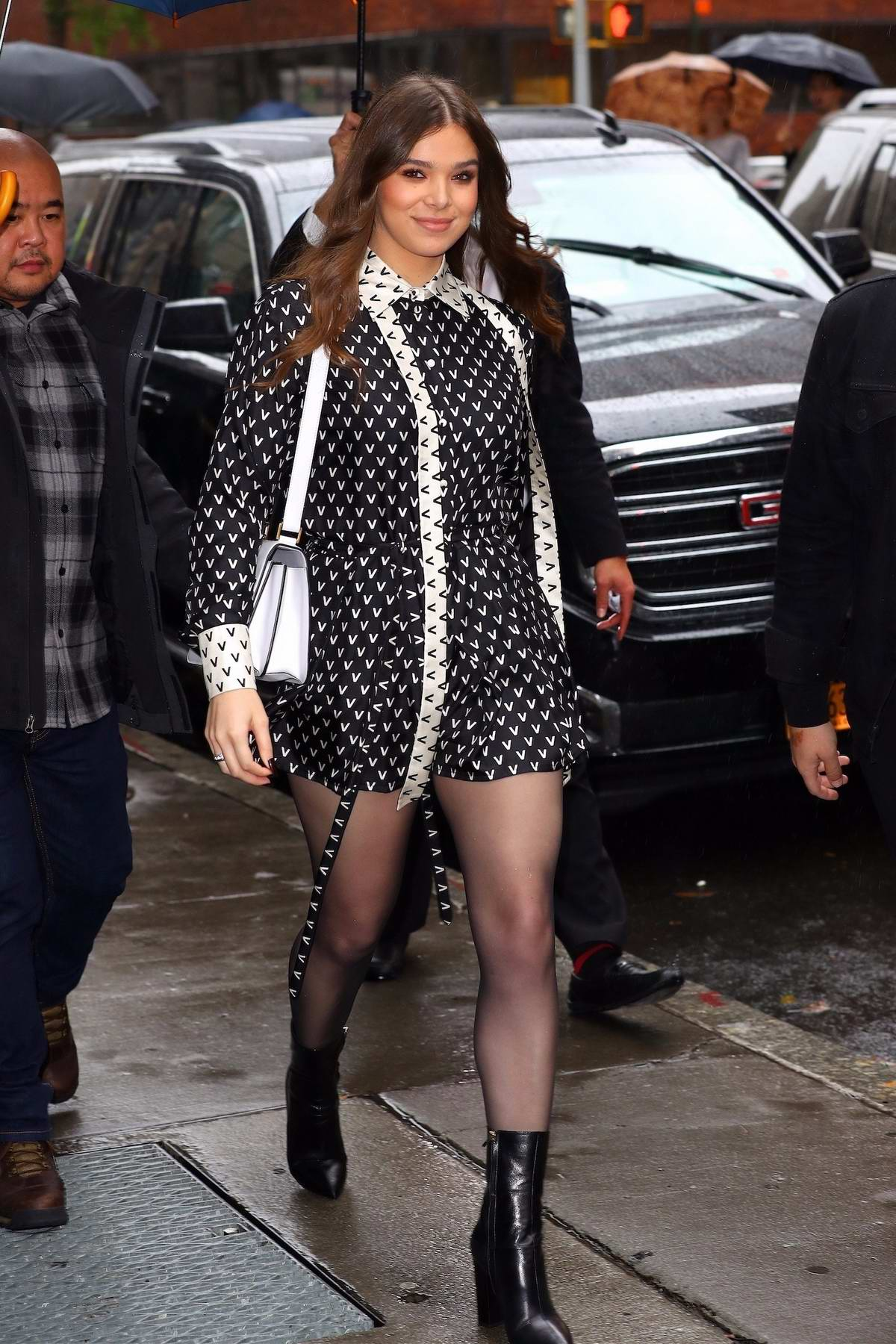 Hailee Steinfeld wears a patterned black and white romper as she visits the Build Series in New York City