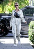 Hailey Bieber looks casual chic in silk outfit paired with a Louis Vuitton fanny pack while out running errands in Los Angeles